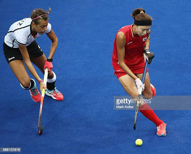 Hyunji Kim of Korea is watched by Selin Oruz of Germany during the Women's Pool B Match between Germany and Korea on Day 5 of the Rio 2016 Olympic...