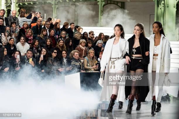HyunJi Shin, Gigi Hadid and Mona Tougaard walks the runway during the Chanel as part of the Paris Fashion Week Womenswear Fall/Winter 2020/2021 on...