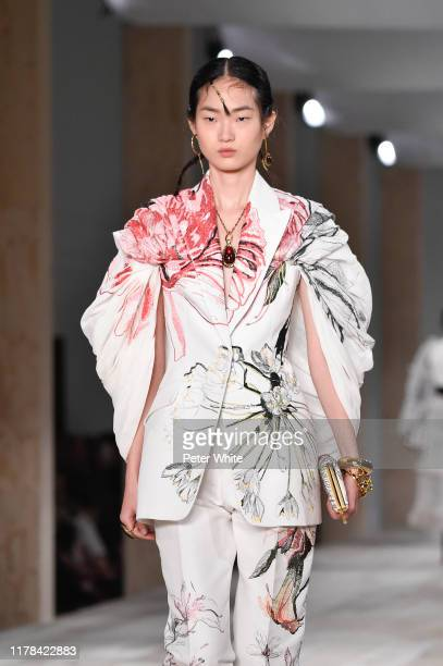HyunJi Shin walks the runway during the Alexander McQueen Womenswear Spring/Summer 2020 show as part of Paris Fashion Week on September 30, 2019 in...