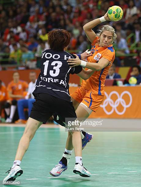 Hyunji Yoo of Korea challenges Estavana Polman of Netherlands during the Womens Preliminary Group A match between Norway and Angola at Future Arena...