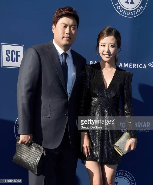 Hyunjin Ryu and Jini Bae arrive at the 5th Annual Blue Diamond Foundation at Dodger Stadium on June 12 2019 in Los Angeles California