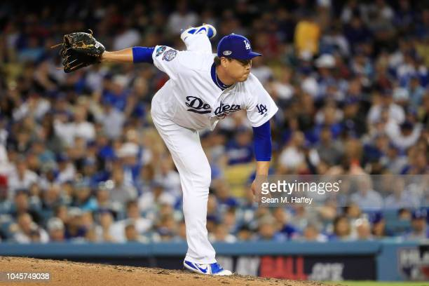 HyunJin Ryu of the Los Angeles Dodgers delivers the pitch against the Atlanta Braves during Game One of the National League Division Series at Dodger...