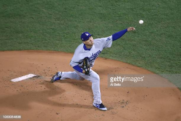 HyunJin Ryu of the Los Angeles Dodgers delivers the pitch during the first inning against the Boston Red Soxin Game Two of the 2018 World Series at...