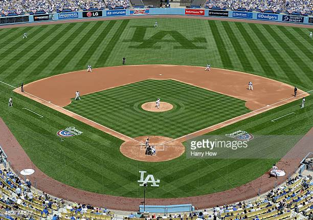 HyunJin Ryu of the Los Angeles Dodgers makes a first pitch to Angel Pagan of the San Francisco Giants to start the game on opening day at Dodger...