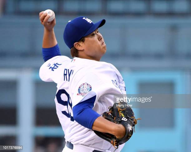 HyunJin Ryu of the Los Angeles Dodgers pitches against the San Francisco Giants during the first inning at Dodger Stadium on August 15 2018 in Los...
