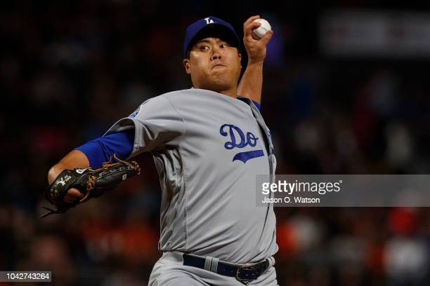 HyunJin Ryu of the Los Angeles Dodgers pitches against the San Francisco Giants during the first inning at ATT Park on September 28 2018 in San...