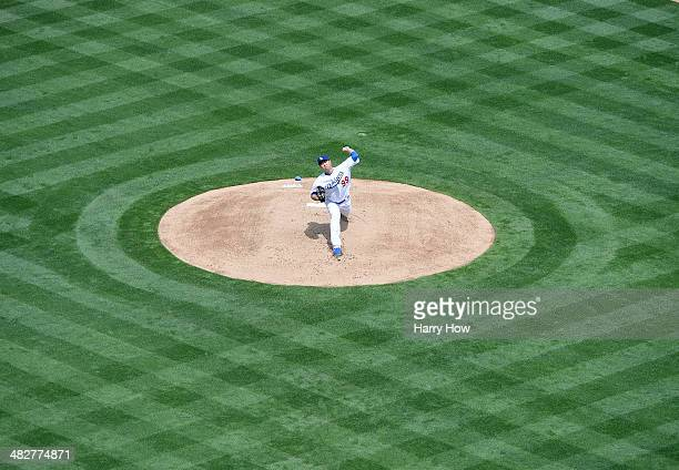 HyunJin Ryu of the Los Angeles Dodgers pitches against the San Francisco Giants during the first inning on opening day at Dodger Stadium on April 4...