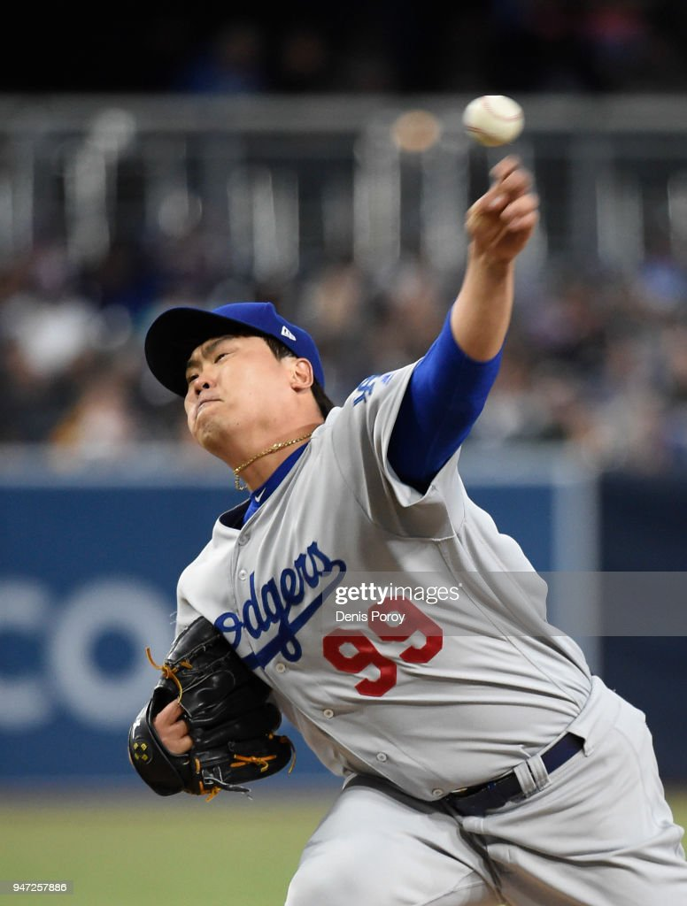 Hyun-Jin Ryu #99 of the Los Angeles Dodgers pitches during the first inning of a baseball game against the San Diego Padres at PETCO Park on April 16, 2018 in San Diego, California.