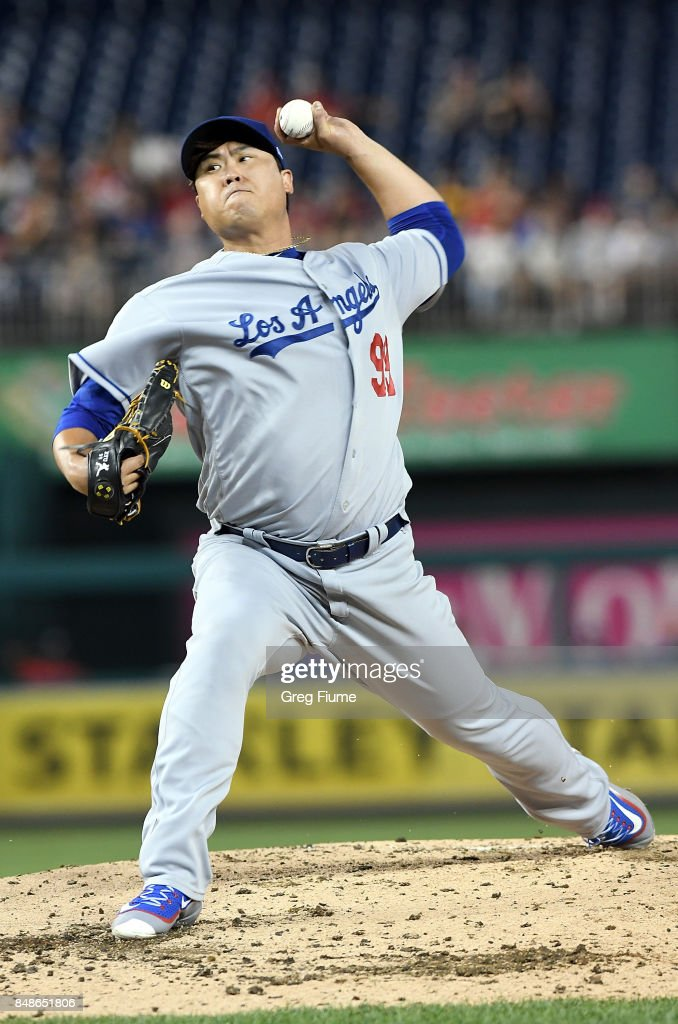 Hyun-Jin Ryu #99 of the Los Angeles Dodgers pitches in the second inning against the Washington Nationals at Nationals Park on September 17, 2017 in Washington, DC.