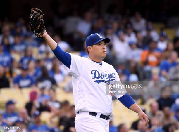 HyunJin Ryu of the Los Angeles Dodgers reacts after a single to Brandon Nimmo of the New York Mets to load the bases during the sixth inning at...