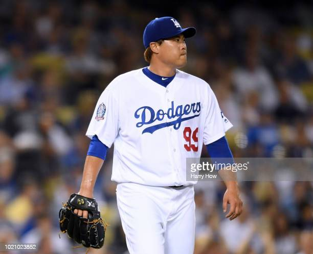 HyunJin Ryu of the Los Angeles Dodgers reacts after giving up a two run homerun to Yadier Molina of the St Louis Cardinals to trail 31 during the...