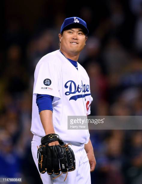 HyunJin Ryu of the Los Angeles Dodgers reacts after his complete game shutout of the Atlanta Braves for a 90 win at Dodger Stadium on May 07 2019 in...
