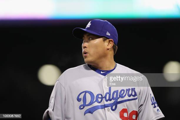 HyunJin Ryu of the Los Angeles Dodgers reacts after retiring the side during the third inning against the Boston Red Sox in Game Two of the 2018...