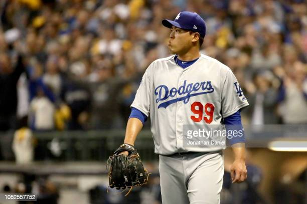 HyunJin Ryu of the Los Angeles Dodgers reacts against the Milwaukee Brewers during the first inning in Game Six of the National League Championship...