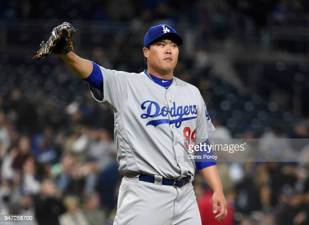HyunJin Ryu of the Los Angeles Dodgers stands on the mound after giving up a two run home run during the second inning of a baseball game against the...