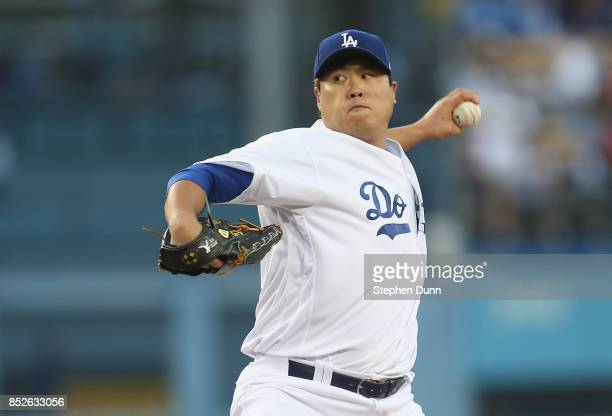 HyunJin Ryu of the Los Angeles Dodgers throws a pitch in the second inning against the San Francisco Giants at Dodger Stadium on September 23 2017 in...