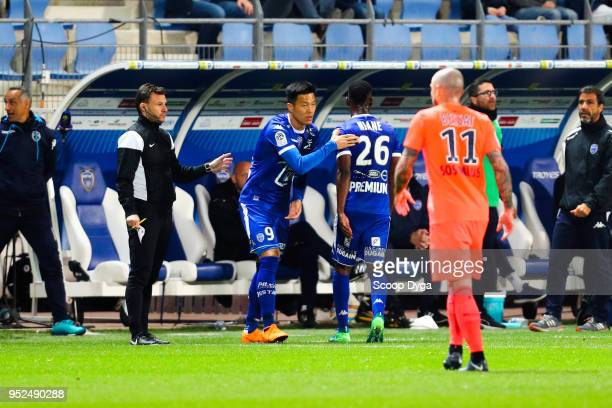 SUK Hyunjun of Troyes and NIANE Adama of Troyes during the Ligue 1 match between Troyes AC and SM Caen at Stade de l'Aube on April 28 2018 in Troyes