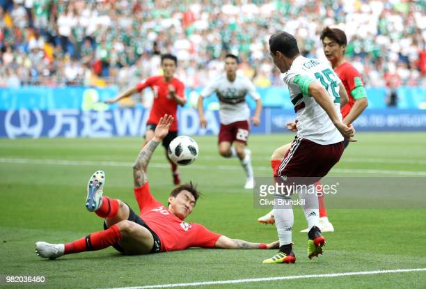 Hyunsoo Jang of Korea Republic handles the ball inside the penalty area, resulting in Mexico being awarded a penalty during the 2018 FIFA World Cup...