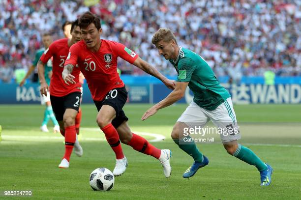 Hyunsoo Jang of Korea Republic is challenged by Timo Werner of Germany during the 2018 FIFA World Cup Russia group F match between Korea Republic and...