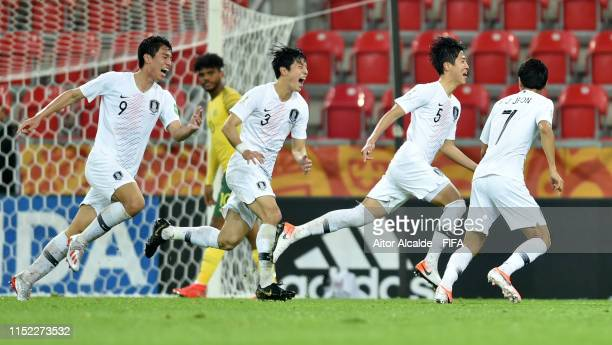 Hyunwoo Kim of Korea Republic celebrates with team mates after scoring his team's first goal during the 2019 FIFA U20 World Cup group F match between...