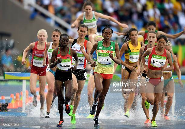 Hyvin Kiyeng Jepkemoi of Kenya Etenesh Diro of Ethiopia and Xinyan Zhang of China compete in round one of the Women's 3000m Steeplechase on Day 8 of...
