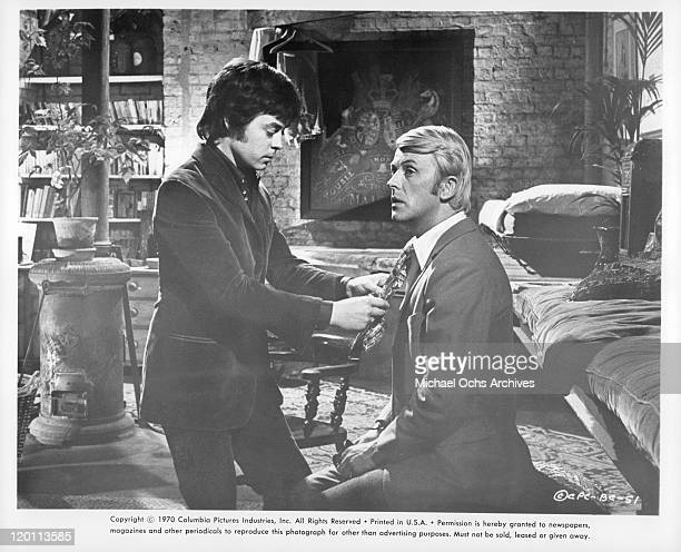 Hywel Bennett adjusting tie of actor in a scene from the film 'The Buttercup Chain', 1970.