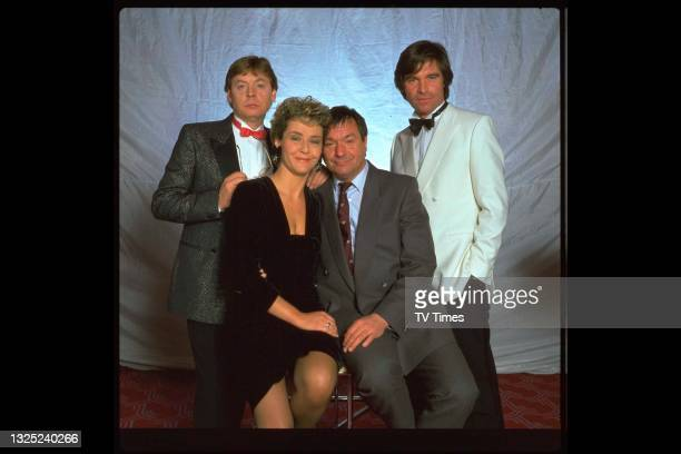Hywel Bennett, Amanda Burton, Michael Elphick and Oliver Tobias in character for 'Charity Begins At Home', a two-part episode of the comedy drama...