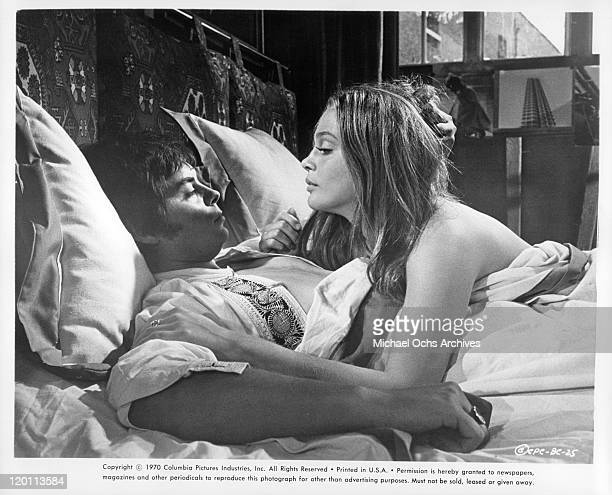 Hywel Bennett and Leigh TaylorYoung in bed in a scene from the film 'The Buttercup Chain' 1970
