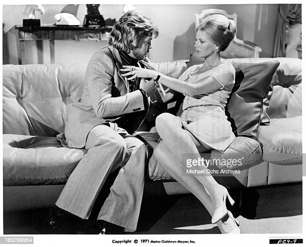 Hywel Bennett sits with Britt Ekland in a scene from the film 'Percy' 1971 Photo by MetroGoldwynMayer/Getty Images