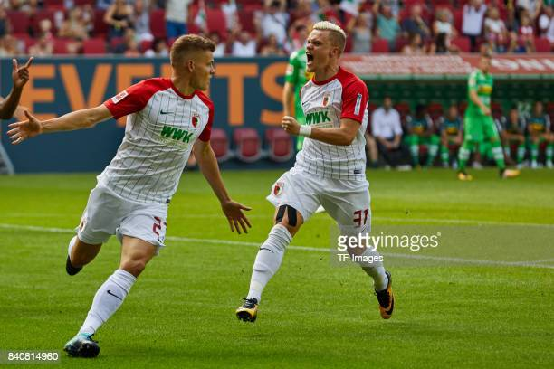 i Alfred Finnbogason of Augsburg and Philipp Max of Augsburg celebrate a goal during a Bundesliga match between FC Augsburg and Borussia...