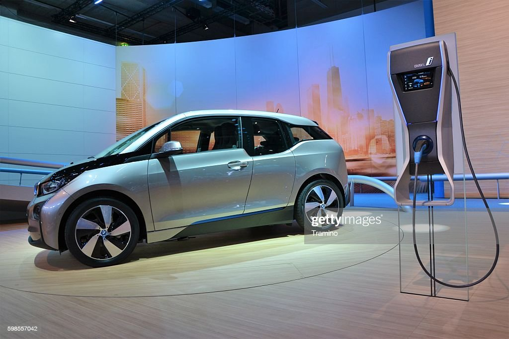 BMW i3 and electric charging point : Stock Photo