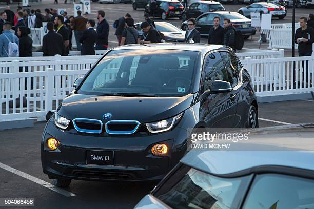 A BMW i3 electric car drives autonomously at the CES 2016 Consumer Electronics Show on January 8 2016 in Las Vegas Nevada AFP PHOTO/ DAVID MCNEW /...