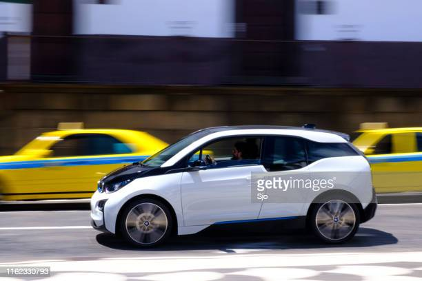 bmw i3 five-door urban electric car driving in the city of funchal at madeira island - hybrid vehicle stock pictures, royalty-free photos & images