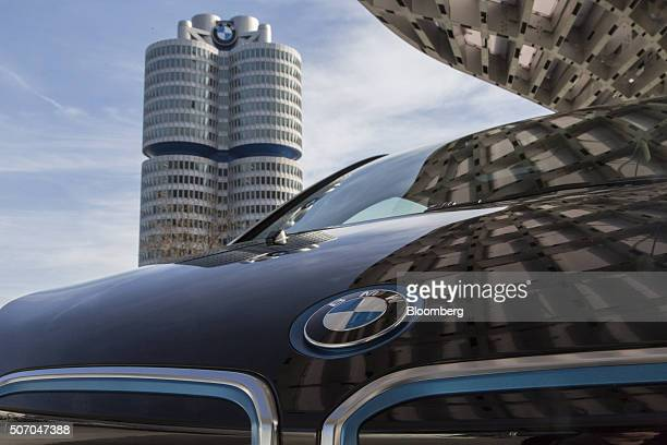 A BMW i3 plugin automobile produced by Bayerische Motoren Werke AG sits outside the BMW World showroom as the automaker's headquarter towers stand...