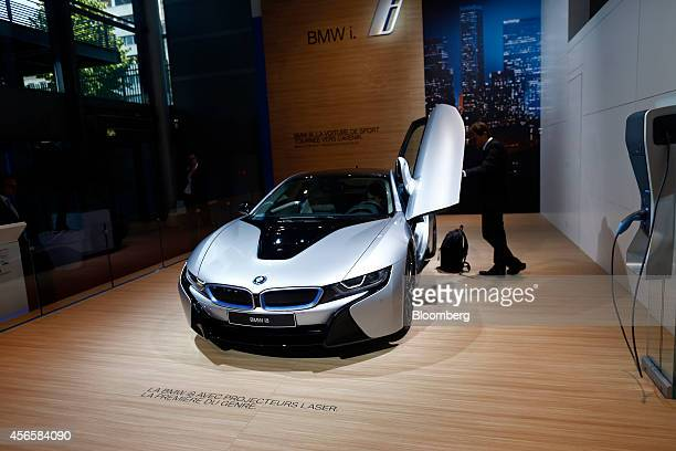 A BMW i8 electric sportscar produced by Bayerische Motoren Werke AG sits on display at the Paris Motor Show on the final preview day in Paris France...