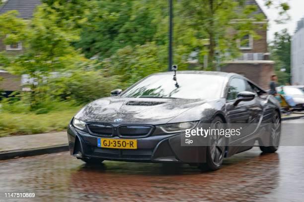 BWW i8 Hybrid sports car driving in the rain