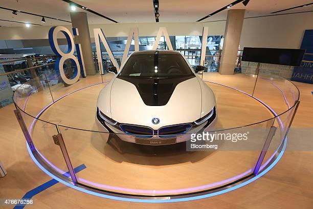A BMW i8 plugin hybrid automobile manufactured by Bayerische Motoren Werke AG sits on display inside the BMW World showroom in Munich Germany on...
