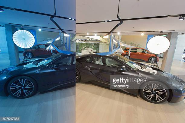 A BMW i8 plugin hybrid automobile produced by Bayerische Motoren Werke AG sits on display inside the BMW World showroom in Munich Germany on Tuesday...