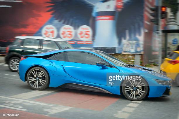 bww i8 plug-in hybrid sports car on the street - bmw i8 stock photos and pictures