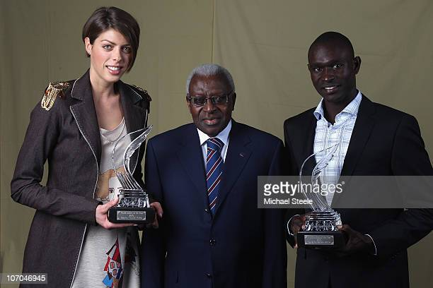 Iaaf President MrLamine Diack poses with Blanka Vlasic of Croatia and David Rudisha of Kenya as they receive the athletes of the year award during...