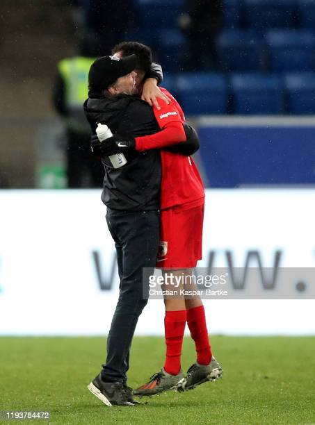 Iago Amaral Borduchi of Augsburg is congratulated by Martin Schmidt the haed coach of Augsburg during the Bundesliga match between TSG 1899...