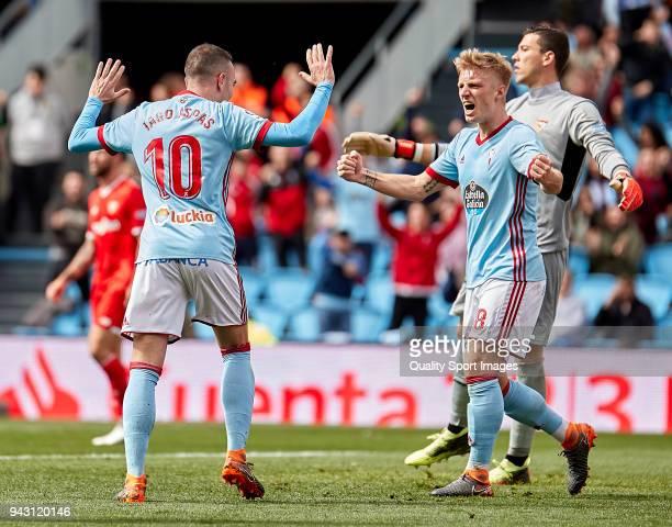 Iago Aspas and Daniel Wass of Celta de Vigo celebrate Guilherme Arana of Sevilla FC scores by own goal during the La Liga match between Celta de Vigo...