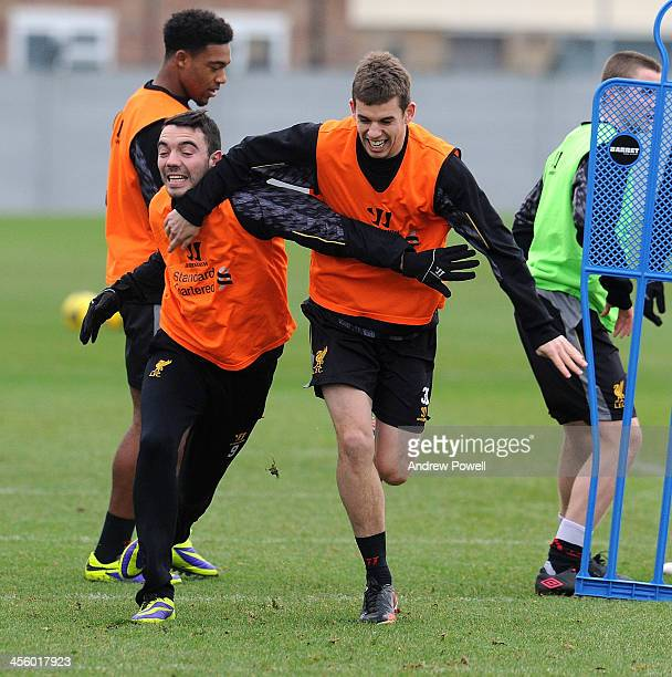 Iago Aspas and Jon Flanagan of Liverpool in action during a training session at Melwood Training Ground on December 13 2013 in Liverpool England