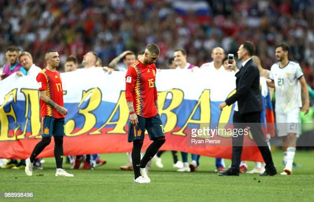Iago Aspas and Sergio Ramos of Spain look dejected following the 2018 FIFA World Cup Russia Round of 16 match between Spain and Russia at Luzhniki...