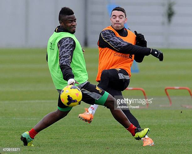 Iago Aspas and Yalany Baio of Liverpool in action during a training session at Melwood Training Ground on February 21 2014 in Liverpool England