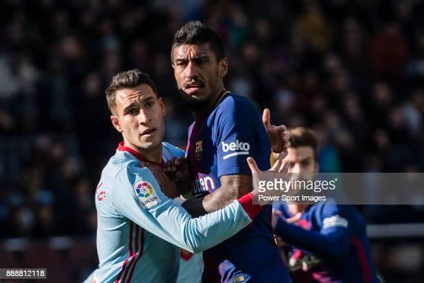 Iago Aspas Juncal of RC Celta de Vigo fights for position with Paulinho Maciel of FC Barcelona during the La Liga 201718 match between FC Barcelona...
