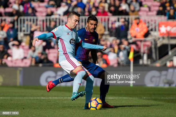 Iago Aspas Juncal of RC Celta de Vigo fights for the ball with Paulinho of FC Barcelona during the La Liga 201718 match between FC Barcelona and RC...