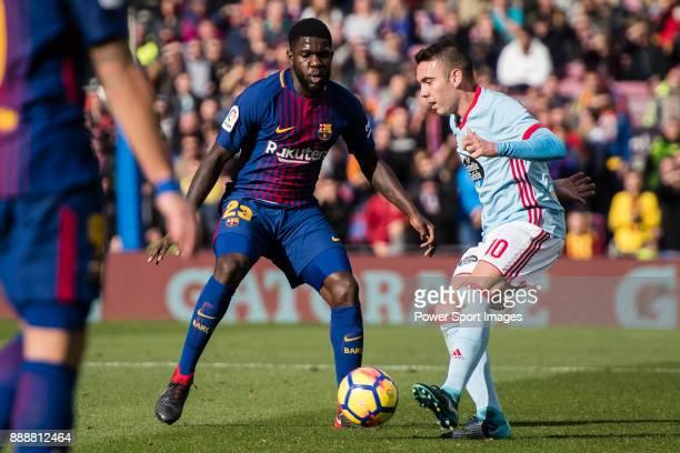 Iago Aspas Juncal of RC Celta de Vigo in action Samuel Umtiti of FC Barcelona during the La Liga 201718 match between FC Barcelona and RC Celta de...