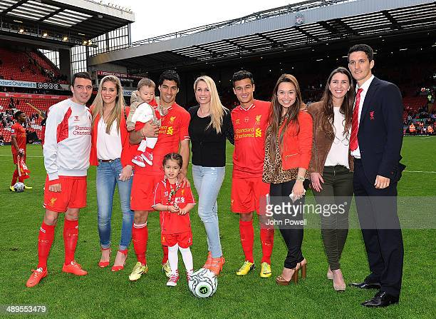 Iago Aspas Luis Suarez Philippe Coutinho and Luis Alberto of Liverpool with their partners at the end of the Barclays Premier League match between...