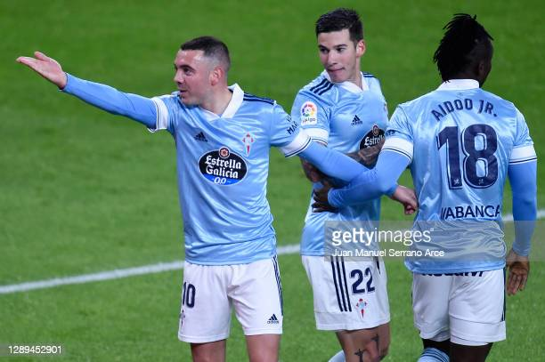 Iago Aspas of Celta de Vigo celebrates his team's second goal with teammates Santi Mina and Joseph Aidoo during the La Liga Santander match between...